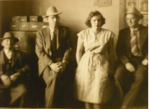 "My grandfather, S.S. ""Nick"" Nichols (second from left), and his staff in the Sheriff's Office, 1947. He was still wearing a suit and Stetson when he served as Constable years later."